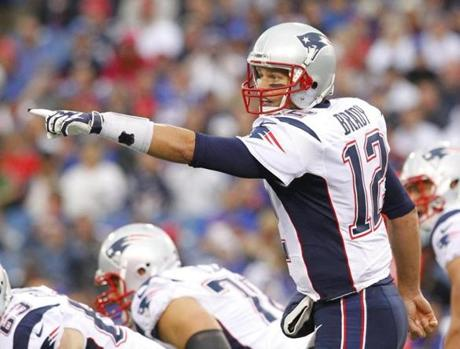 Tom Brady  directed his offense during the first half.